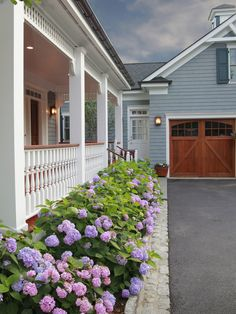 Love the detached garage in the back with the beautiful carriage doors!