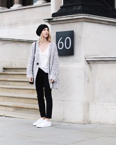 A White Shirt, a Gray Sweater, Black Pants, and White Sneakers