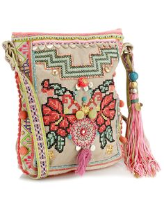 Las Salinas Embroidered X Body 3892699900 $56.00 Unique embellished cross body with neon embroidery, pattern shoulder strap, pom poms and large tassel charm.