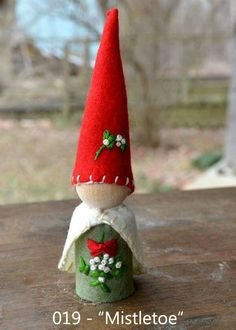 """""""Mistletoe"""" -- peg gnome handmade from wooden peg, wool felt, and cotton floss. Wood Peg Dolls, Clothespin Dolls, Christmas Projects, Holiday Crafts, Xmas Ornaments, Christmas Decorations, Christmas Fairy, Wooden Pegs, Fairy Dolls"""