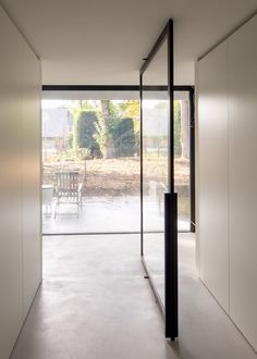 Elegant glass pivot doors made from black anodised aluminium. Portapivot is always made-to-measure and ships it's hardware systems worldwide! Pivot Doors, Internal Doors, Sliding Doors, Door Design, House Design, Crittall, Construction, Showcase Design, House Rooms
