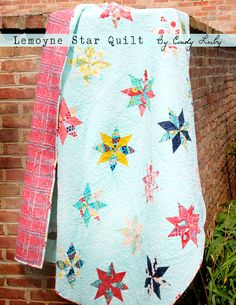 PDF for Cindy's beautiful Lemoyne Star Quilt using rapid fire lemoyne star ruler