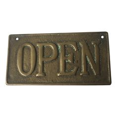 Vintage brass open/closed sign.