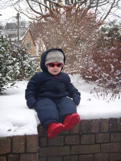 Nathaniel's first time sitting in snow