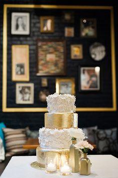 gold cake with white flowers, photo by Photography Stylistas http://ruffledblog.com/elegant-parisian-styled-wedding #gold #weddingcakes #cake