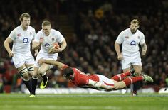 England's Chris Ashton is tackled by Wales' Jamie Roberts during their Six Nations international rugby union match at the Millennium Stadium...