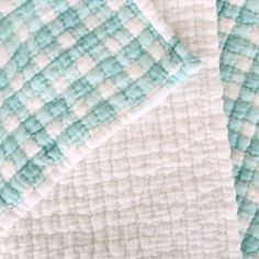 Find a step by step illustrated guide to creating a hand quilted cotton gauze baby blanket. These blankets are extremely soft!