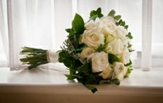 Flower Gallery | Bay Tree Trading - Home Accessories & Interior Design. Wedding Bouquet of White Avalanche Roses, Ranunculus, Freesia n& Sencio