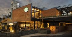 Starbucks' new 'Coffee Sanctuary' in Bali is its largest store in Southeast Asia, and there's even a coffee farm you can walk through Starbucks New Coffee, Starbucks Store, Starbucks Reserve, Commercial Architecture, Facade Architecture, Coffee Farm, Coffee Store, Modern Architecture, Tents