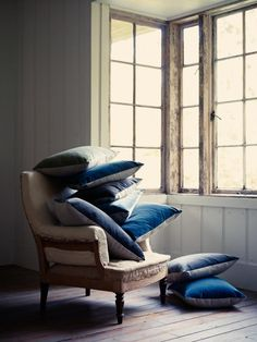 Ian Mankin, chair with cushions made from ticking fabric and velvet