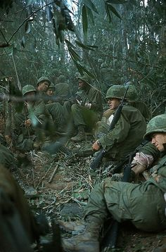 https://flic.kr/p/MY9ZL9 | Dak To 1967 - Wounded soldiers on Hill 875 awaiting evacuation | November 21, 1967 Dak To, South Vietnam - Wounded soldiers of the 173rd Airborne Brigade sit together in this densely wooded area as they await evacuation from Hill 875 as the fighting continues, November 21. Here, soldiers sit with their rifles, and one soldier in the background smokes a cigarette.