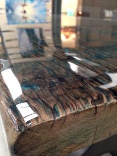 Zoom from reclaimed wood tabletop with colour coating
