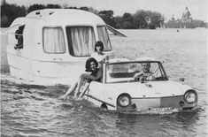 1. Camping Goals  From a '67 magazine ad: the legentary amphibious +convertible Amphicar Model 770, pulling the ab fab 4.30m long amphibious +fully equi