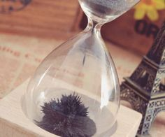 3df9d8aac4 Entertain your eyes as you keep track of time with the magnetic sand  hourglass. Rather