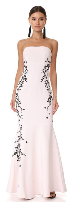 luna embroidered gown by Cinq A Sept. A strapless Cinq a Sept gown with contrast laurel embroidery at the sides. Flexible boning structures the tailored bo...