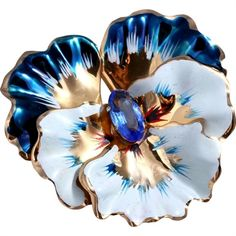 This is a gorgeous Coro sterling silver vermeil pansy brooch! The brooch was handcrafted in the 1940s. The three tier design gives the brooch wonderful dimensionality. The brooch is intricately…MoreMore  #VintageJewelry
