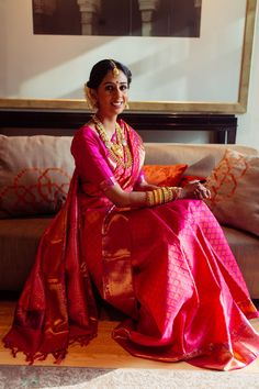 South Indian Bride - Bride in a Fuchsia Pink And Gold Kanjivaram Saree with Gold Jewelry | WedMeGood #wedmegood #indianbride #indianwedding #bridal #southindianbride #southindiansaree #saree #pink #kanivaram