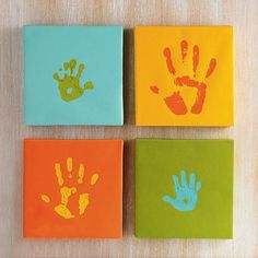 Handprint Canvas Kit DIY  -purchase 10 X 10 canvases and paint to match room colors  -Either hang them all up and only do 1 baby/child hand print each year or do 1 print for Mommy, 1 print for Daddy, and 2 prints (R and L) for baby