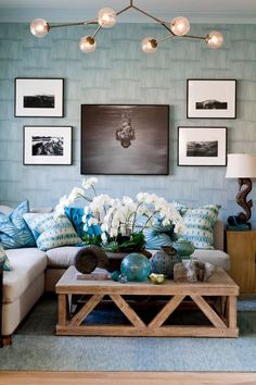 Beautiful beach inspired living room in light blue tones and natural sand colors with a hint of black. Like the seahorse lamp and shell decor. dustjacket attic: Interior Design | Holiday House Hamptons