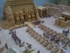 Abu Simbel reimagined for diorama/gamepiece, RPG War Gods of Aegyptus minatures. Overall dimensions of diorama 5 feet by 6 feet. Temples of urethane foam, sculpted and molded resin statuettes, sphinxes ,etc. Game Terrain, 40k Terrain, Tabletop, Life In Ancient Egypt, Tomb Kings, Egypt Map, Dungeon Tiles, Gk Knowledge, Married With Children