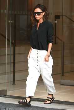 Baggy trousers: Victoria swapped her fitted slacks for a more loose fitting pair on Tuesday