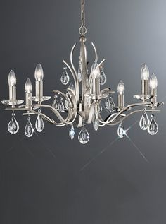 FL2298/8 Willow 8 light chandelier with crystal drops, satin nickel. Tradition chandelier with a modern twist, satin nickel finish adorned with impressive crystal glass drops. 8 x 40w E14 Candle lamps not included Height- 160cm Minimum Height- 59cm Diameter- 80cm Weight- 7Kg BRAND: Franklite  REFERENCE: FL2298/8 AVAILABILITY: 3-4 Working Days