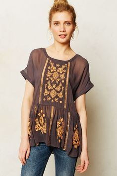 Obsessed with this flowy peplum! Antala Peplum Top - anthropologie.com