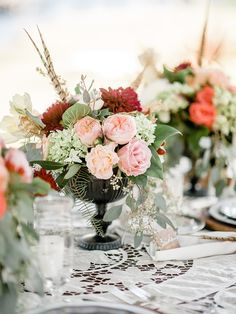 Centerpiece florals with feathers, dahlias and garden roses by A to Zinnias, image by Brandon Lata. #wedding