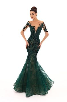 f28dcd34e6f Features an illusion bateau neckline with sheer long sleeves adorned with  sequins