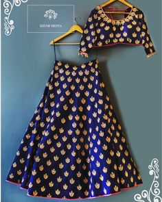 Beautiful royal blue color lehenga and blouse with floral design hand embroidery thread work. Blouse sleeves with pearl hangings. 04 December 2017