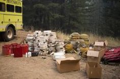 A photo of stacked firefighting equipment ready to be transported from the fire lines.