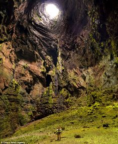 Deep down: Photographer Amy Hinkle shot the spectacular images in January while on a week-long expedition to the caves of the Aquismon region in Mexico    Read more: http://www.dailymail.co.uk/news/article-2288920/Real-life-hobbit-holes-Mexico-330-metre-drop-claimed-dozens-climbers-lives.