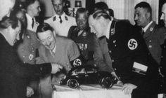 Ferdinand Porsche (yes, THAT Porsche) showcasing the Volkswagen Beetle to Adolf Hitler in 1935.