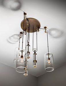 Counterweight Chandelier. The US artist-designer has been working with molten glass since the age of 15 — and has the scars to prove it (Photo: Joshua White) Ceiling Lamp, Ceiling Lights, Glass Art Design, Mason Jar Lamp, Wind Chimes, Light Fixtures, Table Lamp, Lighting, Interior