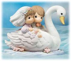 "Precious Moment figurine - ""Til the End Of Time""."