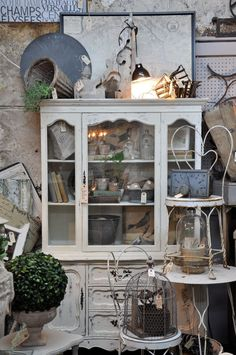 nice cabinet, love the little wire chair