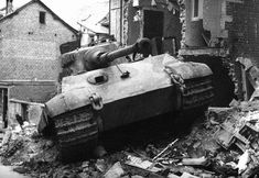 The first of Peiper's King Tigers to be lost was this one (No.105), commanded by the SS-Obersturmführer Jürgen Wessel, which was abandoned after it got stuck in debris on Rue St. Emilion in Stavelot on 18 December 1944.