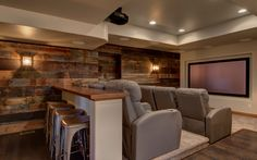 This basement remodel is industrial, modern, and chich for a unique finish cutomized for these homeowners. Including a home theater, bathroom and wet bar! Get your custom-designed basement remodel started with FBC Remodel today. Home Theater Lighting, Home Theater Setup, Best Home Theater, Home Theater Speakers, Home Theater Projectors, Home Theater Design, Home Theater Seating, Theater Seats, Movie Theater