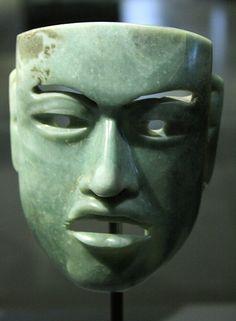 Jade Olmec mask from Tabasco, Mexico. 1000 - 500 BC. 15cmH x 12cmW x 7.3cmD.