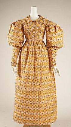Dress 1826, British, Made of cotton ~~~~~ Rich colors such as chrome yellow and Turkey red became popular, and fabrics with large bold checkerboard or plaid patterns became fashionable,(another contrast with the previous fashion period, which had favored small delicate pastel prints).