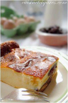 Base    200 gr de farine  200 gr de sucre  4 œufs  1 L de lait  12 à 15 pruneaux  1 càc d'extrait de vanille