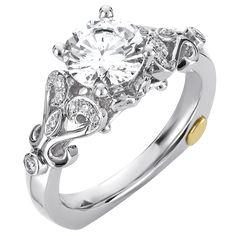 Unique diamond engagement ring by Chad Allison.  It's a stylized vintage hearts that accentuate the center diamond.  Dare to be different and dare to be romanticized wearing this ring.  Style number is ME207