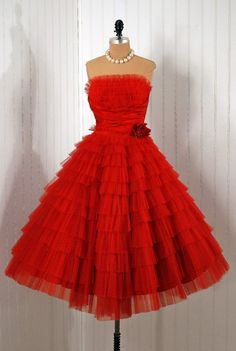 Party Dress: 1950's, tiered ruffles of polka-dot tulle, shelf-bust ruched satin cummerbund, floral applique.