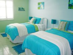 Twin room I decorated for children in our beach house. Fun with aqua and lime green.