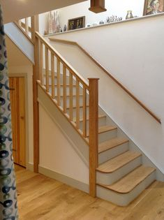 A single winder staircase manufactured in softwood and ash. The softwood elements have been painted in white to create a striking contrast. There are two sided bullnose steps on entry. Glass Stairs, Metal Stairs, Painted Stairs, Wooden Stairs, Bespoke Staircases, Wooden Staircases, Curved Staircase, Staircase Design, Stair Spindles