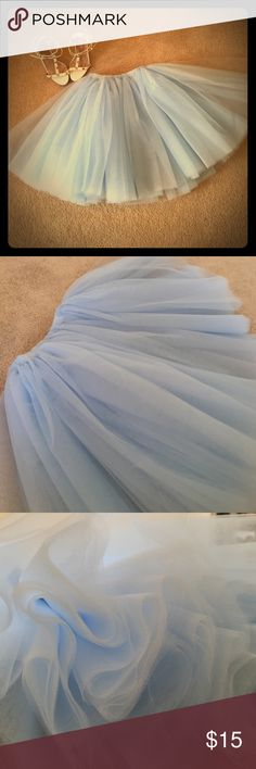 Baby blue tutu Baby blue tutu falls right before knees and is perfect for any fun night out! Skirts