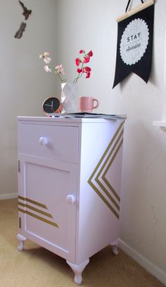 Deco inspired lines that feature on all sides and top of this cute cabinet