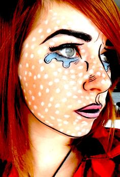 Pop Art face makeup - Use a thin black line (eyeliner or paint) to outline the basic elements of the face including a line around the ear elements, hairline, chin... Add rich colors where needed. Then fill in areas with dots, using the back end of a paint brush.