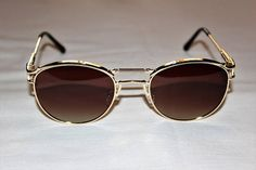 Sunglasses design recalls Gaultier, Matsuda. Frame gold, Lens brown gradient . South Korea Manufacturing.