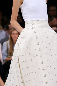 Spring 2015 Ready-to-Wear - Christian Dior -- Detail of t-shirt buttoned to skirt waist.
